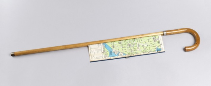 Cane with pull-out map