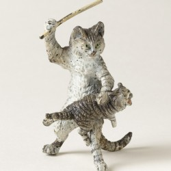 painted brass figurine of a cat standing on hind legs. Standing cat is spanking a smaller cat upon its knee with a stick.